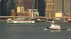 Ferry and  tugboat in east river, New York City, follow shot Stock Footage