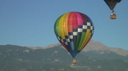 Stock Video Footage of Hot air balloons in front of mountain