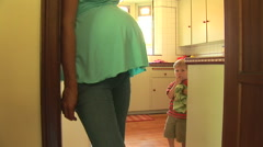 Pregnant mother and young toddler son sharing time together Stock Footage