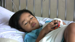 Boy Plays With Cars In Hospital Bed Stock Footage