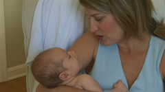 Mother holding newborn Stock Footage