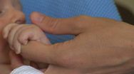 Mother holding newborn baby hand Stock Footage