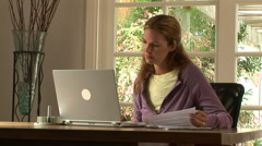 Young woman stressed while working at home with laptop Stock Footage