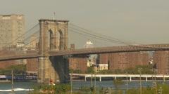American Icons #3 Brooklyn bridge and tug boat, medium shot Stock Footage