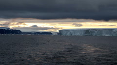 Sunset with Icebergs in Antarctica Stock Footage