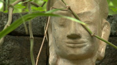 Face of a Buddha statue - stock footage