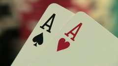 Pocket aces in a deck of playing cards with poker chips - stock footage
