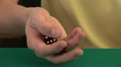 Hands rolling a pair of dice on a poker table Stock Footage