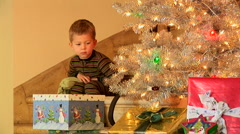 Little boy coming down stairs at Christmas time Stock Footage