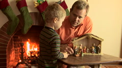 Father and son with nativity scene at Christmas Stock Footage
