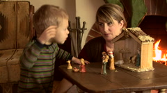 Mother and son with nativity scene at Christmas Stock Footage