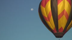 Hot air balloon catches full moon Stock Footage