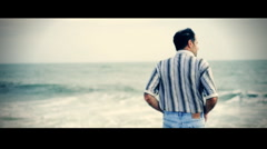 T301 old film letterbox beach standing reflecting thinking slow motion Stock Footage