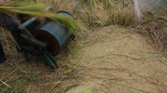Vietnamese farmers use foot powered threshing and sorting machine rice harvest Stock Footage