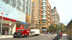New York City, traffic Central park west pan to subway station Stock Footage