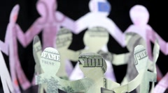 figures of people made of money, keep for hands and rotate - stock footage