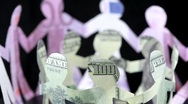 Figures of people made of money, keep for hands and rotate Stock Footage