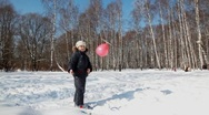 Boy walks and plays with a balloon with propeller Stock Footage
