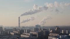 Thermal power station in big city smokes in sky Stock Footage