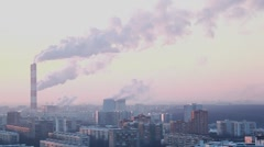 municipal thermal power station in city smokes in sky - stock footage