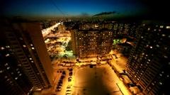 multi-storeyed house and street illumination at night - stock footage