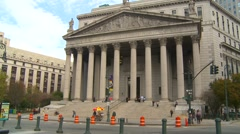 New York City, traffic passing in front of state court house, wide shot Stock Footage