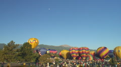 Hot air balloons await morning ascent Stock Footage