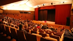 People sit in auditorium for watching performance of hypnotist Anatoly - stock footage