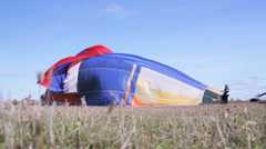 Releasing air from the big balloon on the ground Stock Footage
