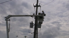 HD Electric Energy Workers fixing Transformer in Boom Canister Truck Stock Footage