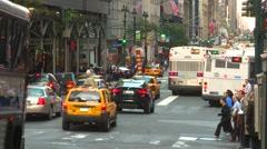 New York City, a busy midtown Manhattan commuter bus cross traffic shot, medium  Stock Footage