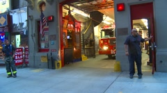 American Icons #10 FDNY firetruck leaves fire-hall, hand-held Stock Footage
