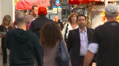 New York City, SOHO neighborhood, more people walking on sidewalk, long shot Stock Footage