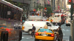 Midtown Manhattan commuter bus, cross traffic, police, people, medium more Stock Footage