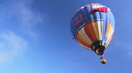 Stock Video Footage of Big hot air balloon flying in the blue sky