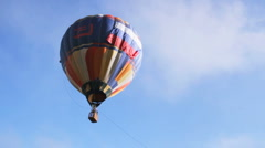 Big hot air balloon flying in the blue sky Stock Footage
