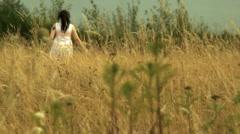 Ladie in field Stock Footage