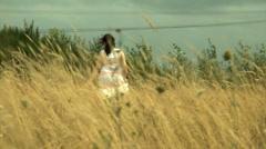 Lady in field Stock Footage