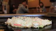 Okonomiyaki cooking in a Japanese Restaurant Stock Footage