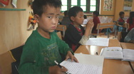 Asian Boy Kids in Elementary School Primary Classroom Learning to Read and Write Stock Footage