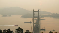 Tsing Ma Bridge and  ship at Sunset Stock Footage