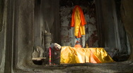 Stock Video Footage of Sleeping buddha station in Orange robe in the big shrine of Angkor Wat