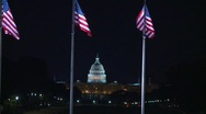 Stock Video Footage of Wash DC, Capitol hill and US flags long lens at night