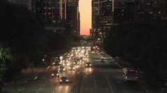 DOWNTOWN TRAFFIC AT DUSK A2 Stock Footage