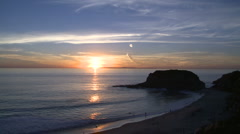 Sunset over the ocean with islands and beach Stock Footage