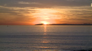 Sunset behind island in the ocean Stock Footage
