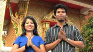 Asian Man And Woman Do Thai Greeting Stock Footage