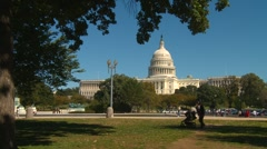 Wash DC, Capitol hill framed with trees, nice autumn afternoon Stock Footage
