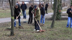 Manual labour. Cleaning in city park - stock footage