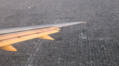 Airplane wing over LA turning Stock Footage